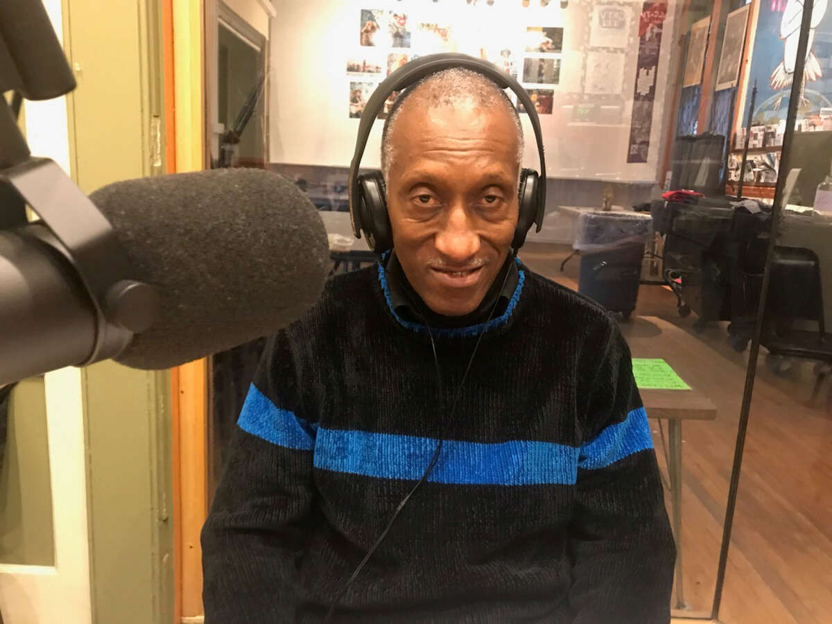 Willie Terry, a labor activist and retired state worker who is the labor correspondent for the Troy radio station WOOC (105.3 FM), sits in the studio at the station, located at the Sanctuary for Independent Media in Troy. (Provided photo.)