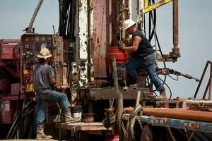 Another section of pipe is prepared for a well drilled between Alpine and Marfa in Presidio County in this 2014 file photo. Private equity firms that have poured funding into the Permian Basin are making adjustments as it becomes more challenging to find funds for drilling projects.