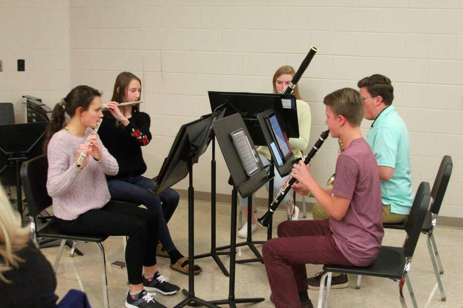An ensemble of Manistee High School Band members performed several musical numbers at Wednesday's Board of Education meeting. January is School Board Recognition Month, and the board was honored for its service by several groups at the meeting. (Ken Grabowski/News Advocate)