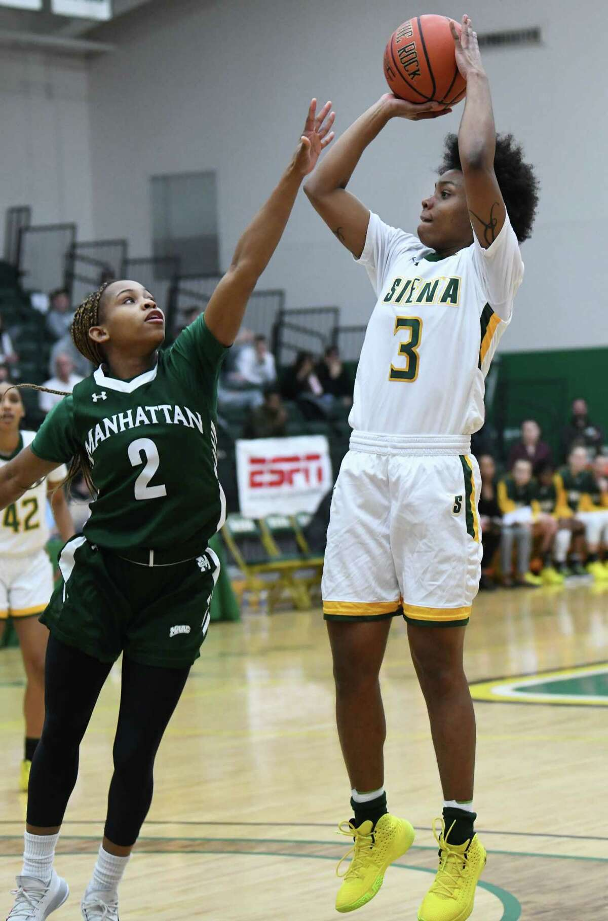 Siena's Rayshel Brown takes a jump shot over Manhatten defensive player Gabby Cajou during a game on Thursday, Jan. 16, 2020 in Loudonville, N.Y. It was also the