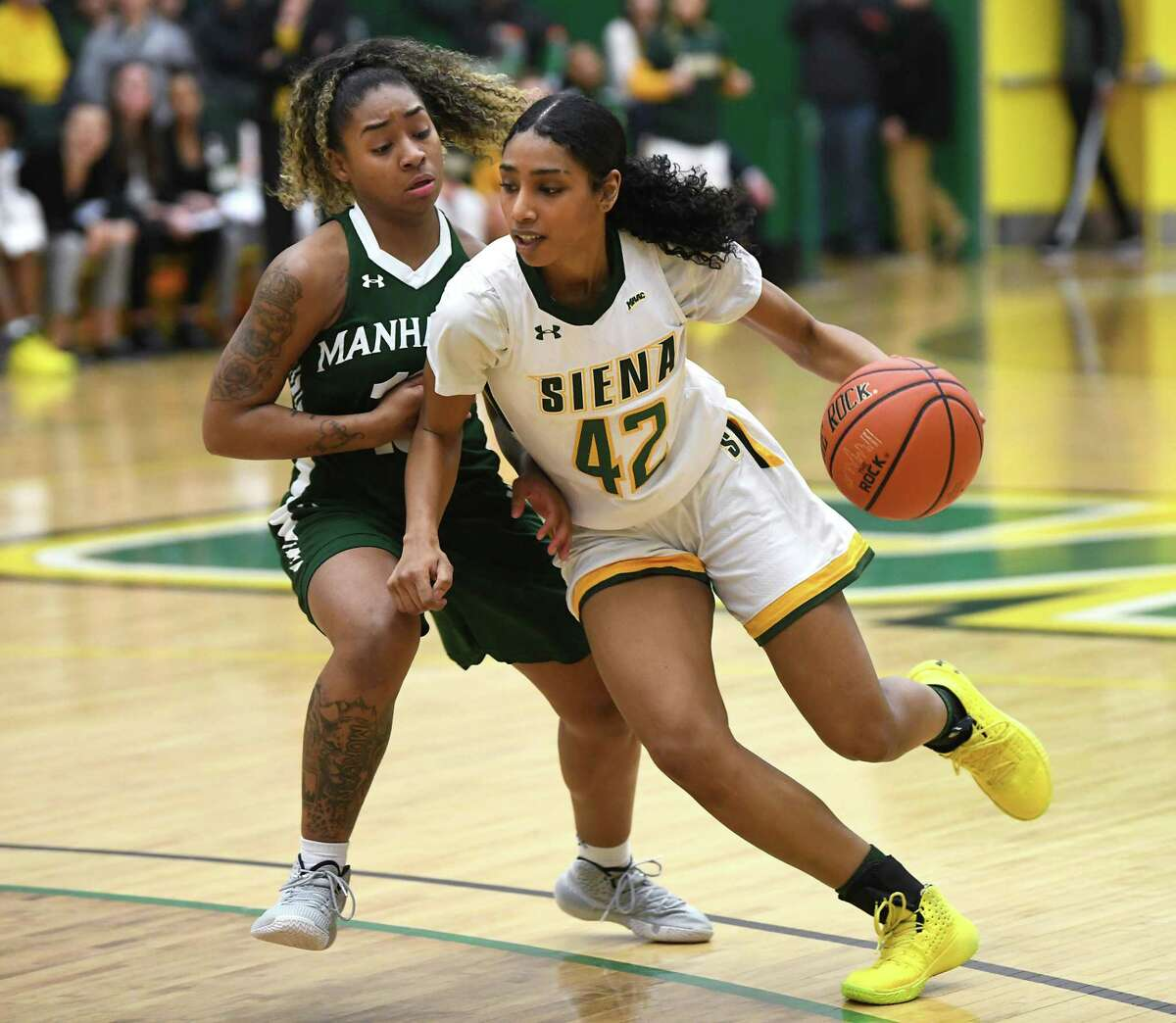 Siena's Sabrina Piper drives to the basket against Manhattan's Lizahya Morgan during a game on Thursday, Jan. 16, 2020 in Loudonville, N.Y. It was also the