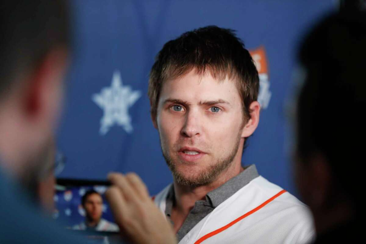 Houston Astros outfielder Josh Reddick is interviewed by local media members before the start on the Astros Caravan at St. Arnold's Brewery, in Houston, January 16, 2020. Reddick did not answer questions pertaining to the Astros cheating scandal.