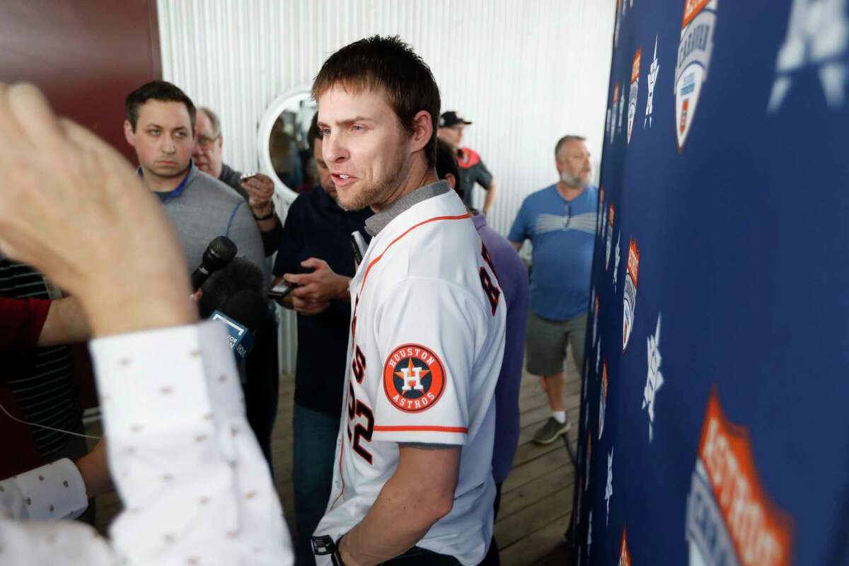 """Houston Astros outfielder Josh Reddick is interviewed by local media members before the start on the Astros Caravan at St. Arnold's Brewery, in Houston, January 16, 2020. Reddick did not add any details to the Astros cheating scandal other than to say the situation """"stinks."""""""