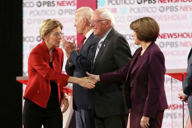 U.S. Sen. Elizabeth Warren, left, greets Sen. Amy Klobuchar at the debate in December. A month later, they are among their party's top hopefuls, along with Joe Biden and Bernie Sanders.