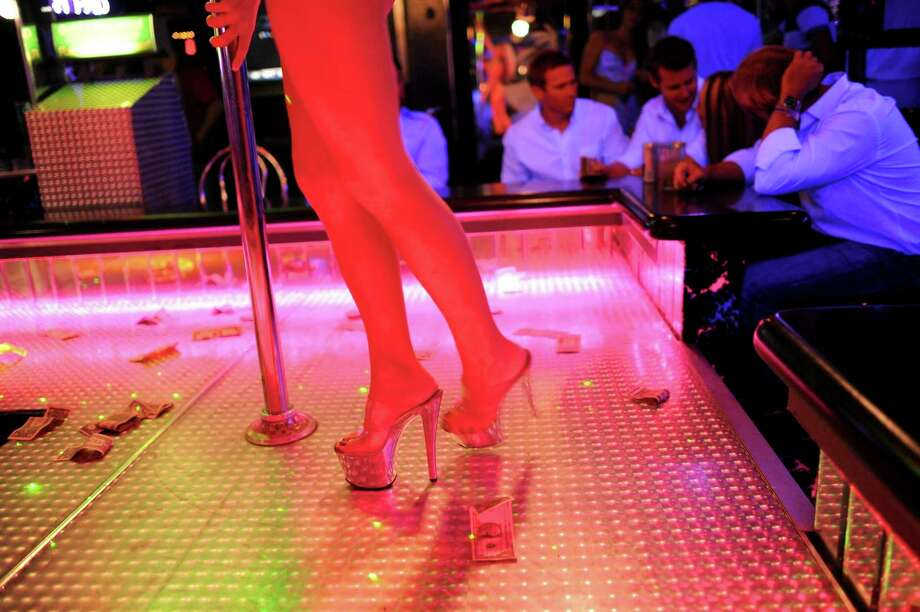 """A woman who worked for more than a year at a Dickinson strip club sued over allegations the manager never paid her regular wages and skimmed off her tip money to pay the doorman and """"house mother,"""" among others. Houston lawyer Jarrett L. Ellzey said there's a pattern of this kind of payment scheme at strip clubs across the country. Photo: BRIAN BLANCO, STR / NYT / NYTNS"""