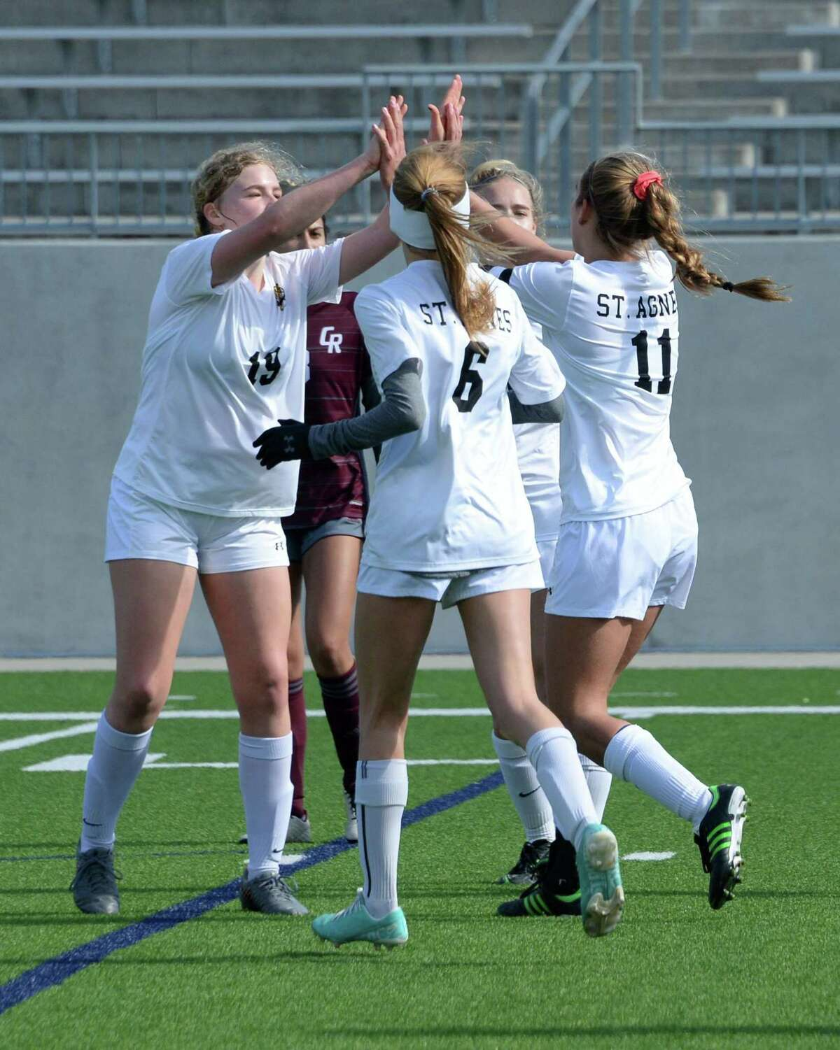 The Tigers celebrate a goal by Lauren Geczik (11) on a penalty kick during the first half of a high school soccer game between the Cinco Ranch Cougars and the St. Agnes Tigers in the Cougar Bracket final of the I-10 Shootout on Saturday, January 11, 2020 at Legacy Stadium, Katy, TX.