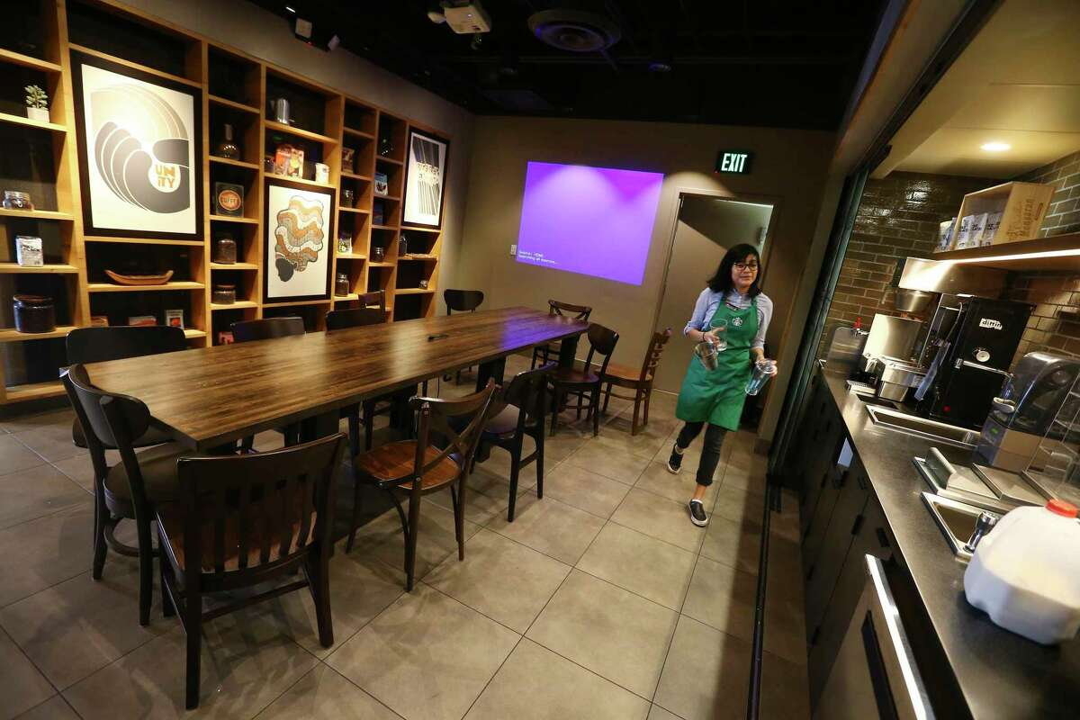 In this Wednesday, Jan. 15, 2020, photo, Belith Ariza, a barista trainer at Starbucks, does some prep work at a barista training station in the community meeting space at a local Starbucks Community Store, in Phoenix. (AP Photo/Ross D. Franklin)