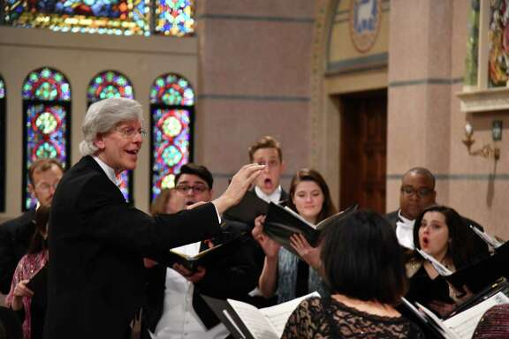 """Robert Simpson, left, founder and artistic director of Houston Chamber Choir, directs the voices that have been nominated for a 2020 Grammy for """"Best Choral Performance."""""""