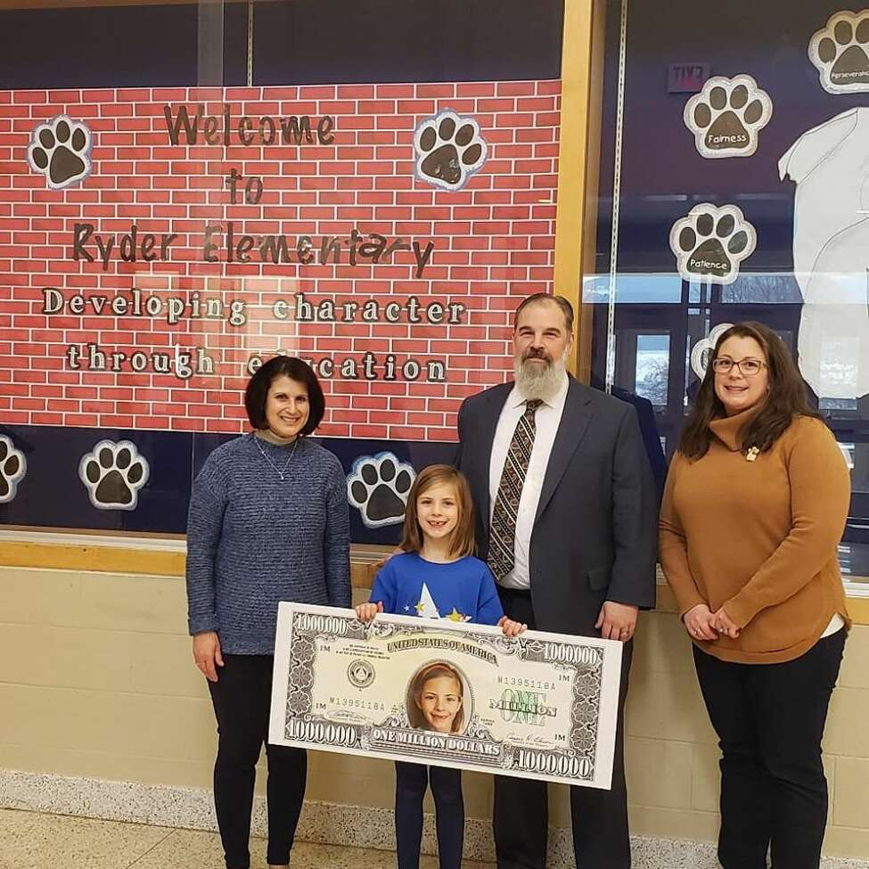 Emily Testa, a second-grader at George D. Ryder Elementary School in Cobleskill-Richmondville, was treated like a Millionaire for a Day by First New York Federal Credit Union. The credit union has been teaching thousands of area students for years to save their money through its KID$ (Keep Investing Dollars Savings) Program. To celebrate the students' success, the credit union randomly selected a school banker to be treated like a millionaire. Emily and her classmates were treated to a pizza lunch and ice cream social and she had an on-air interview with 99.5 The River on Facebook Live.