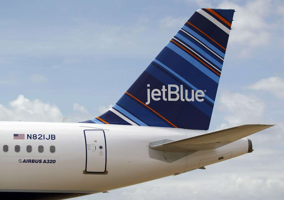 (FILES) In this file photo taken on April 08, 2013 a JetBlue A320 is parked at Brookley Field after a ground breaking ceremony for an assembly line for the Airbus A320 at Brookley Aeroplex in Mobile, Alabama. - The no-frills US air carrier JetBlue will go carbon neutral for all domestic flights starting the summer of this year, the company announced January 6, 2020. (Photo by Matthew Hinton / AFP) (Photo by MATTHEW HINTON/AFP via Getty Images)