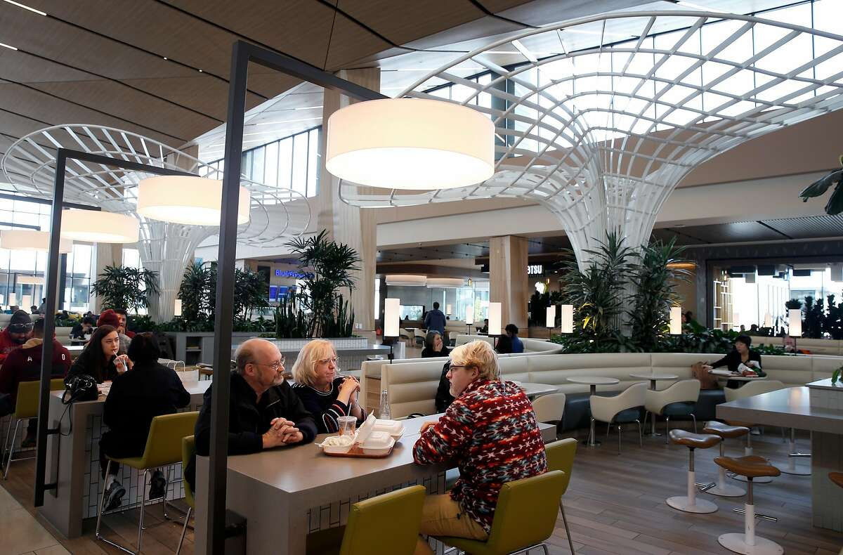 Shoppers have lunch in the new dining terrace at the Hillsdale Shopping Center in San Mateo, Calif. on Wednesday, Jan. 15, 2020. The shopping center underwent an extensive renovation.