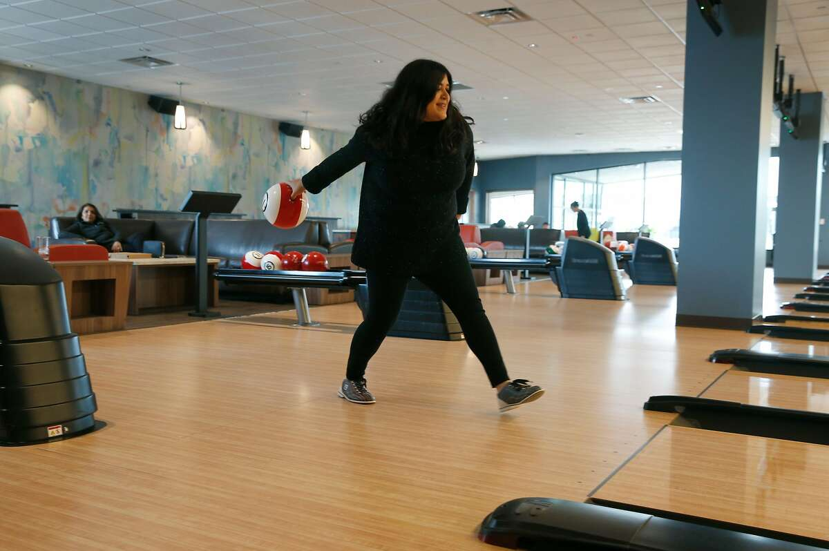 A visitor launches a ball at the Pinstripes bowling, bocce and bistro entertainment center at the Hillsdale Shopping Center in San Mateo, Calif. on Wednesday, Jan. 15, 2020. The shopping center underwent an extensive renovation.