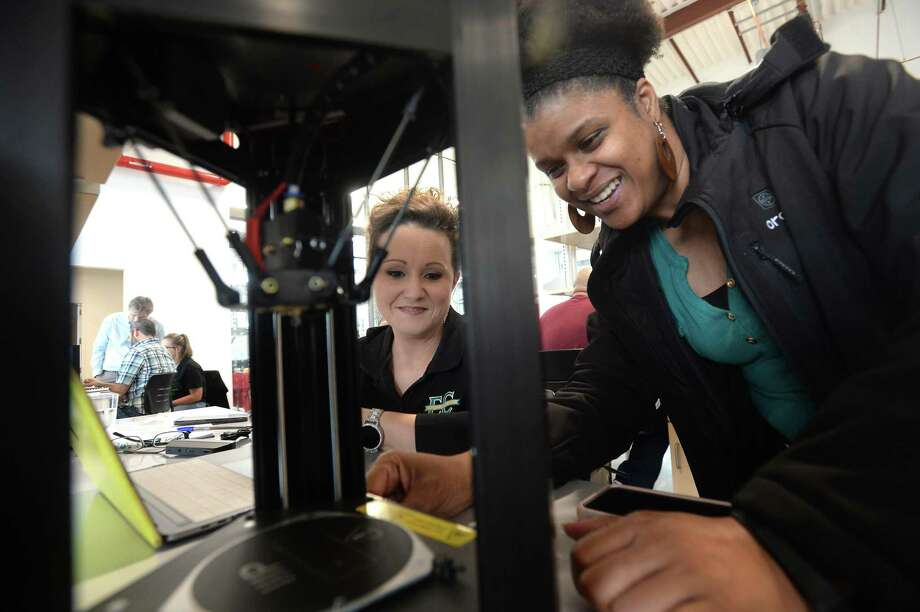 BISD STEM coordinator Marinette Parkerson (right) works with East Chambers science teacher Denise Pattison while learning to operate a 3-D printer as part of a STEM seminar for area teachers hosted by Lamar University at the Science & Technology Building Thursday. The day-long session offered science teachers of several disciplines with instructional ideas in addition to the 3-D printing segment. Each school was given a portable 3-D printer and related materials to take back for use in the classroom. Photo taken Thursday, Jan. 16, 2020 Kim Brent/The Enterprise Photo: Kim Brent / The Enterprise / BEN