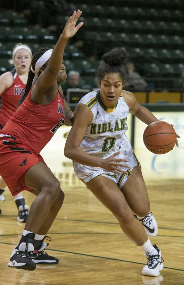 Midland College's Ella Tofaeono drives the lane as Howard College's Armani Harris defends 01/16/20 at the Chaparral Center Tim Fischer/Reporter-Telegram Photo: Tim Fischer/Midland Reporter-Telegram