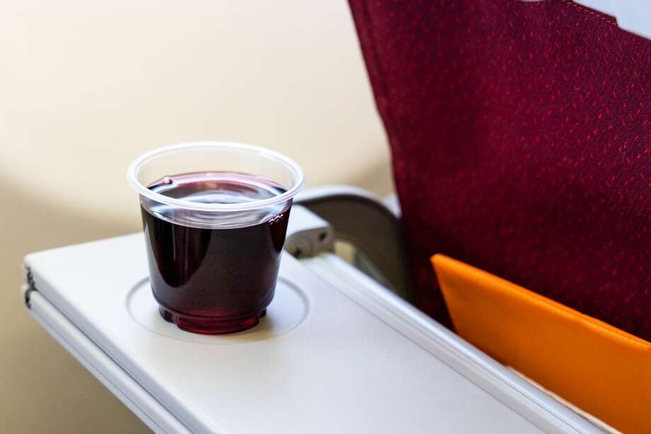 Master Sommelier David Glancy and Master Cicerone Nicole Erny have advice on the best drinks to order on a flight. Scroll ahead for their picks. Photo: ThamKC/Getty Images/iStockphoto