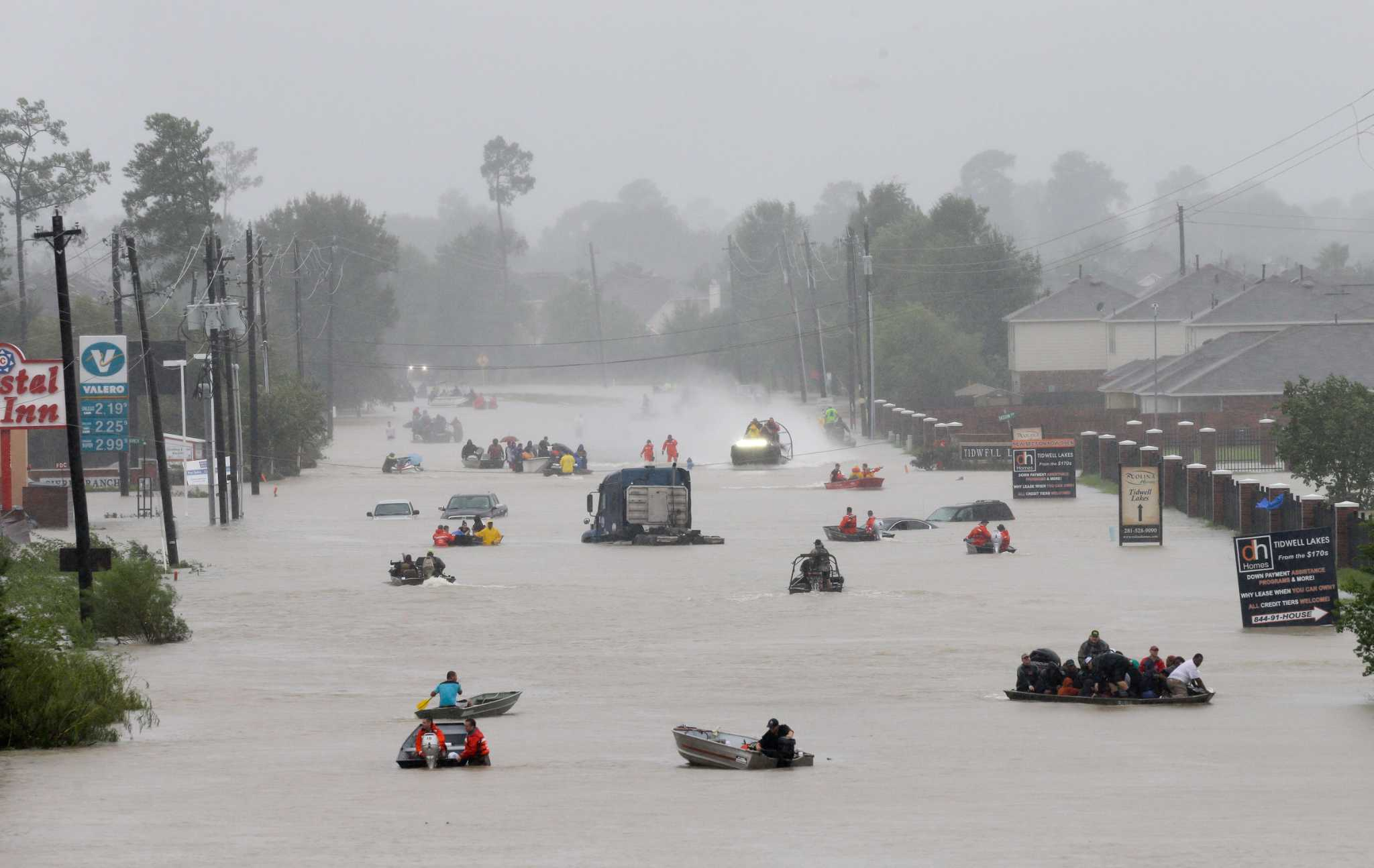 Rescue boats work along Tidwell at the east Sam Houston Tollway helping to evacuate people on August 28, 2017. Climate change has become a matter of risk managment.