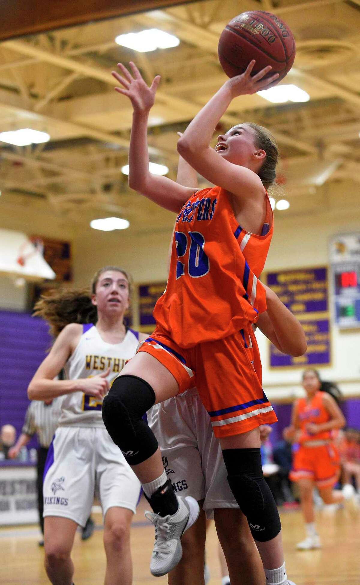 Danbury's Tenley Wallin (20) puts up a shot in the first half of an FCIAC girls basketball game against Westhill in Stamford, Conn. on Jan. 16, 2020. Danbury defeated Westhill 60-35.