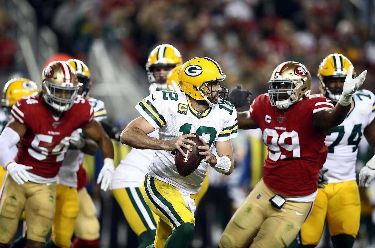 SANTA CLARA, CALIFORNIA - NOVEMBER 24: Quarterback Aaron Rodgers #12 of the Green Bay Packers looks to pass during the game against the San Francisco 49ers at Levi's Stadium on November 24, 2019 in Santa Clara, California. ~~