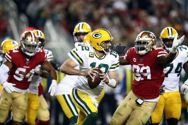 SANTA CLARA, CALIFORNIA - NOVEMBER 24: Quarterback Aaron Rodgers #12 of the Green Bay Packers looks to pass during the game against the San Francisco 49ers at Levi's Stadium on November 24, 2019 in Santa Clara, California. ~~
