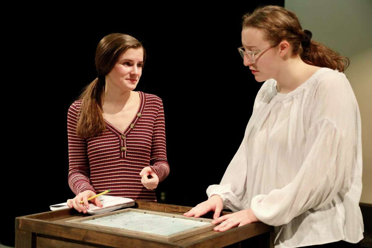 """Freshman Audrey Huff and Senior Lucy Basile rehearse for the upcoming RHS production of """"Silent Sky"""", opening Jan. 23 at 7:30 p.m. in the Black Box Theatre at Ridgefield High School."""