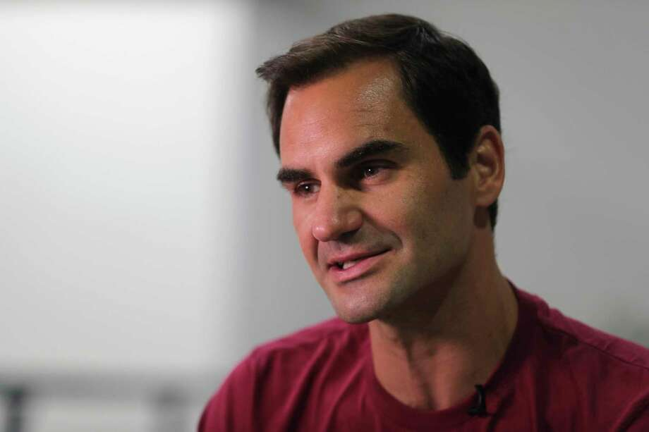 FILE - In this Sunday, Dec. 15, 2019, file photo, Roger Federer talks to an Associated Press reporter in Dubai, United Arab Emirates. Federer figures Rafael Nadal and Novak Djokovic both will surpass his men's record for Grand Slam titles. Federer also says he's OK with that because he had his moment on top. (AP Photo/Kamran Jebreili, File) Photo: Kamran Jebreili / Copyright 2019 The Associated Press. All rights reserved