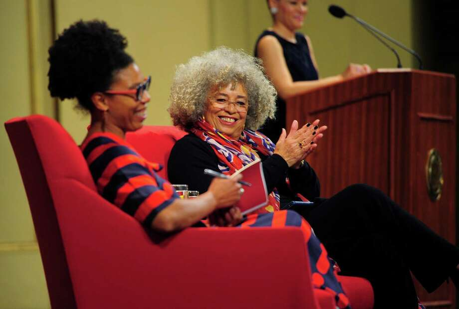 Angela Davis, center, is the guest speaker at Yale University's Martin Luther King commemoration in New Haven on Thursday Jan. 15, 2020. On stage with Davis is Yale professor Crystal Nicole Feimster. Davis, a celebrated activist, educator, and author, has been deeply involved in movements for social justice around the world. Photo: Christian Abraham / Hearst Connecticut Media / Connecticut Post
