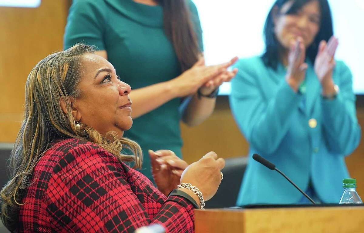Kathy Blueford-Daniels wipes away tears after talking about her murdered son during the swearing-in ceremony for the four newly elected Houston ISD trustees Thursday, Jan. 16, 2020 in Houston.