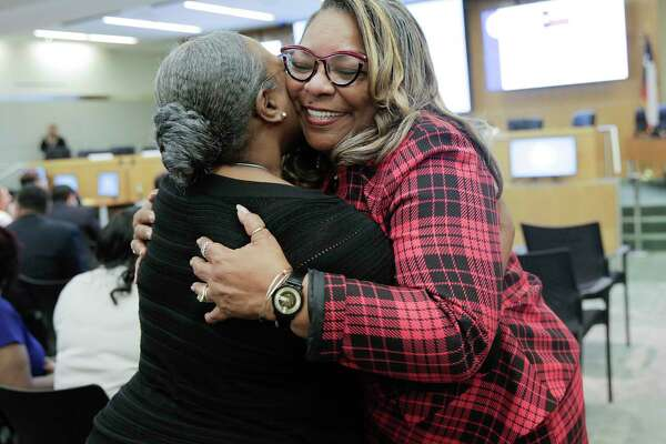 Kathy Blueford-Daniels hugs a supporter before the swearing in ceremony for the elected Houston ISD trustees Thursday, Jan. 16, 2020 in Houston.