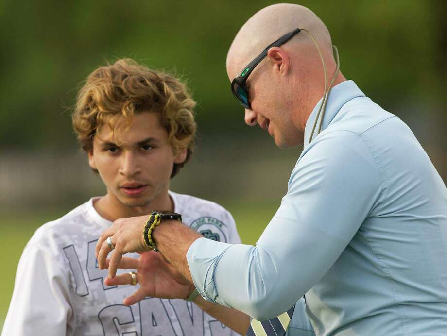 In this file photo, College Park head coach John Owens talks with forward Jesse Botello (14) during the first period of a Region II-6A semifinal match at Kelly Reeves Athletic Complex, Friday, April 12, 2019, in Austin. Photo: Jason Fochtman, Houston Chronicle / Staff Photographer / © 2019 Houston Chronicle