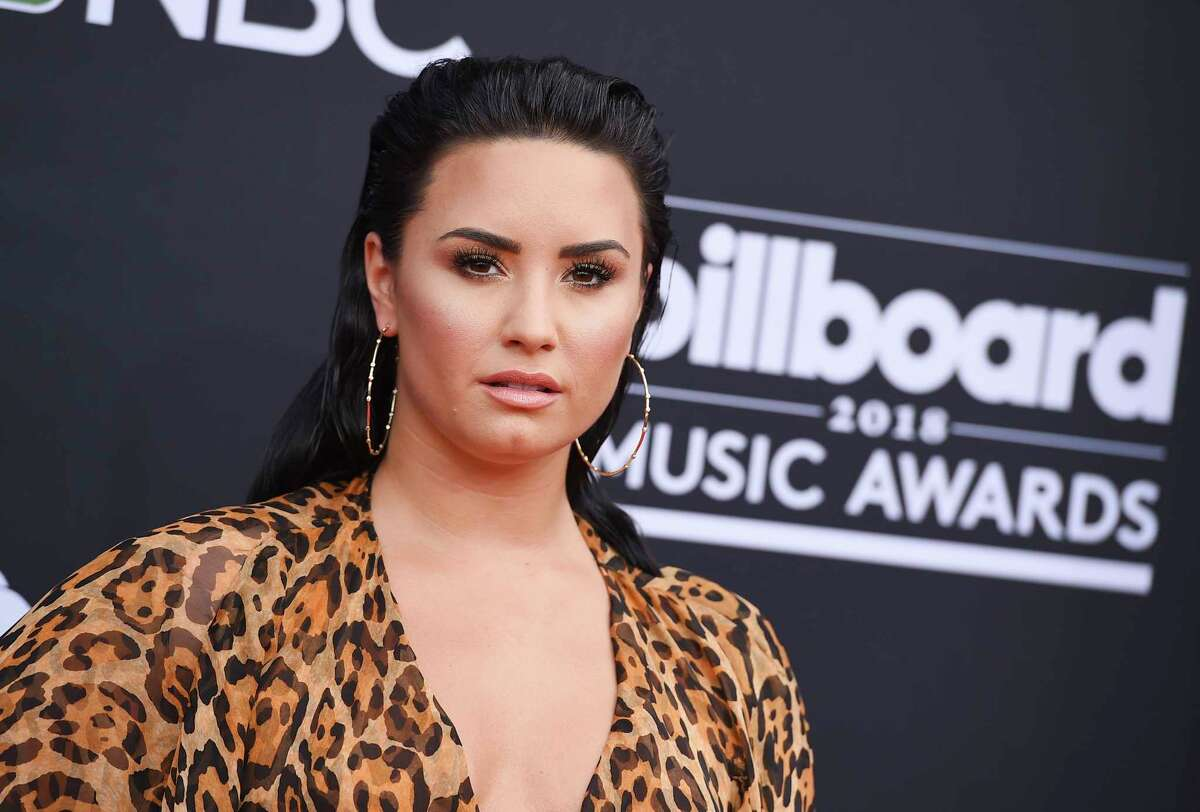 FILE - In this May 20, 2018, file photo, Demi Lovato arrives at the Billboard Music Awards at the MGM Grand Garden Arena in Las Vegas. Lovato has deleted her Twitter account following criticism that she was laughing at memes about 21 Savage. The Grammy-nominated rapper was taken into federal immigration custody in the Atlanta area early Sunday, Feb. 3, 2019. An official said the artist is a British citizen who overstayed his visa and also has a felony conviction. (Photo by Jordan Strauss/Invision/AP, File)