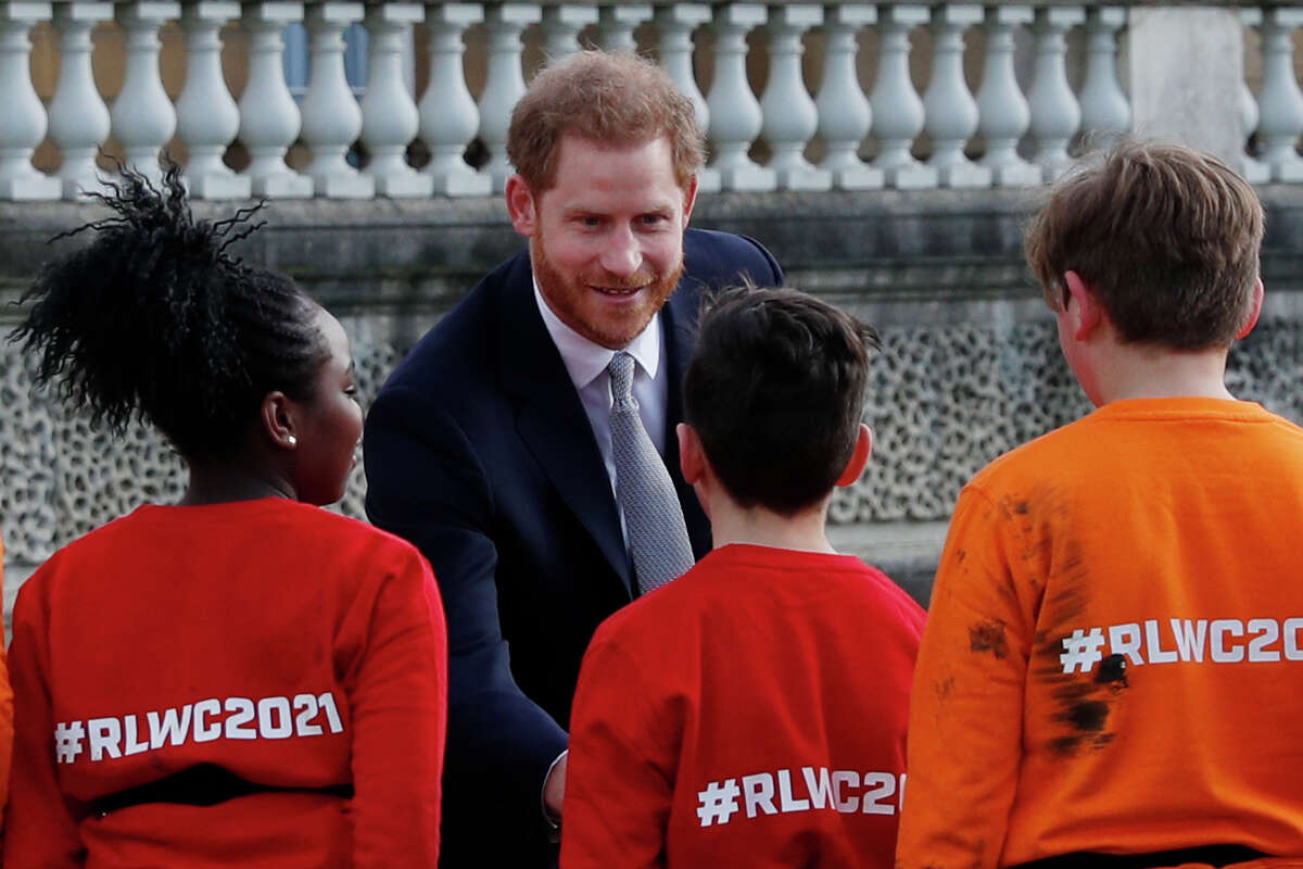 Britain's Prince Harry, Duke of Sussex speaks to children playing rugby league prior to the draw for the Rugby League World Cup 2021 at Buckingham Palace in London on January 16, 2019. (Photo by Adrian DENNIS / AFP) (Photo by ADRIAN DENNIS/AFP via Getty Images)