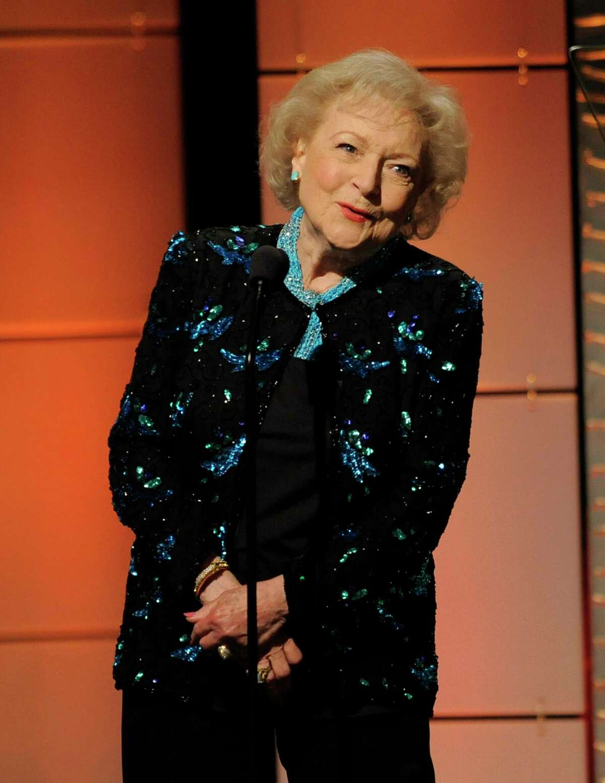 Betty White presents the lifetime achievement award at the 40th Annual Daytime Emmy Awards on Sunday, June 16, 2013, in Beverly Hills, Calif. (Photo by Chris Pizzello/Invision/AP)
