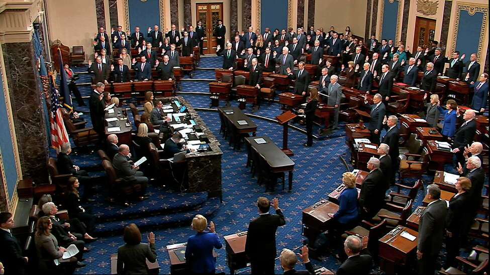 In this image from video, presiding officer Supreme Court Chief Justice John Roberts swears in members of the Senate for the impeachment trial against President Donald Trump at the U.S. Capitol in Washington, Thursday, Jan. 16, 2020. (Senate Television via AP)