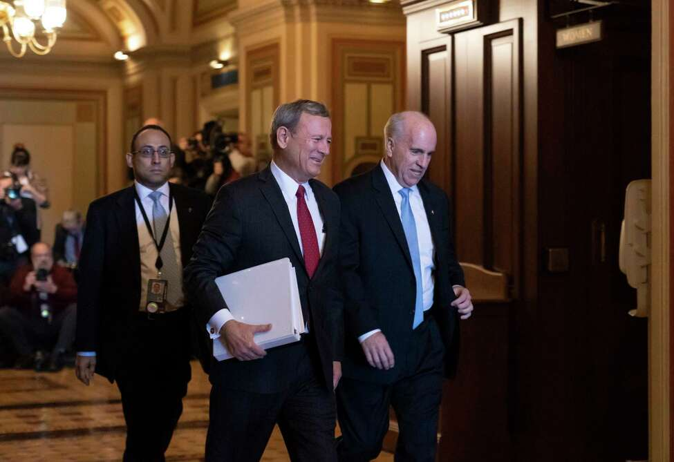 Chief Justice of the United States John Roberts arrives at the Senate to preside at the impeachment trial of President Donald Trump on charges of abuse of power and obstruction of Congress, at the Capitol in Washington, Thursday, Jan. 16, 2020. He is escorted by Senate Sergeant at Arms Michael Stenger, right. (AP Photo/J. Scott Applewhite)
