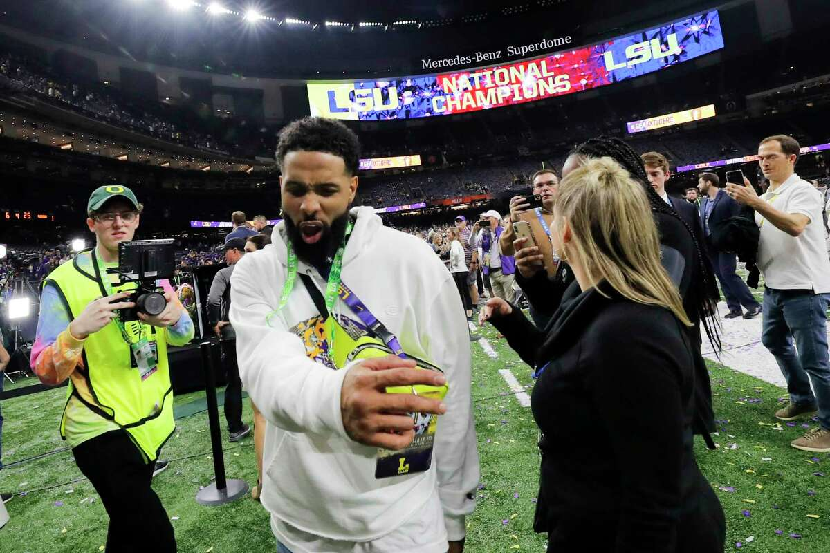 In this Tuesday, Jan. 14, 2020 photo, Cleveland Browns wide receiver and former LSU star Odell Beckham Jr. walks off the field after the NCAA College Football Playoff national championship game between Clemson and LSU in New Orleans. A misdemeanor simple battery warrant has been issued for Beckham police in New Orleans said Thursday, Jan. 16, 2020. The warrant comes as video posted on social media appears to show Beckham swatting a security officer's buttocks during LSU's locker room victory celebration after Monday night's college national championship game in the Superdome. (AP Photo/Gerald Herbert)