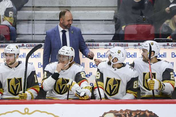 Vegas Golden Knights new head coach Peter DeBoer is seen on the bench as they take on the Ottawa Senators during the first period of an NHL hockey game, Thursday, Jan. 16, 2020 in Ottawa, Ontario. (Sean Kilpatrick/The Canadian Press via AP)