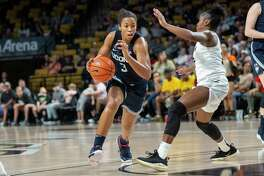Connecticut forward Megan Walker (3) moves the ball as Central Florida guard Kay Kay Wright (2) defends during the first half of an NCAA college basketball game in Orlando, Fla., Thursday, Jan. 16, 2020. (AP Photo/Willie J. Allen Jr.)