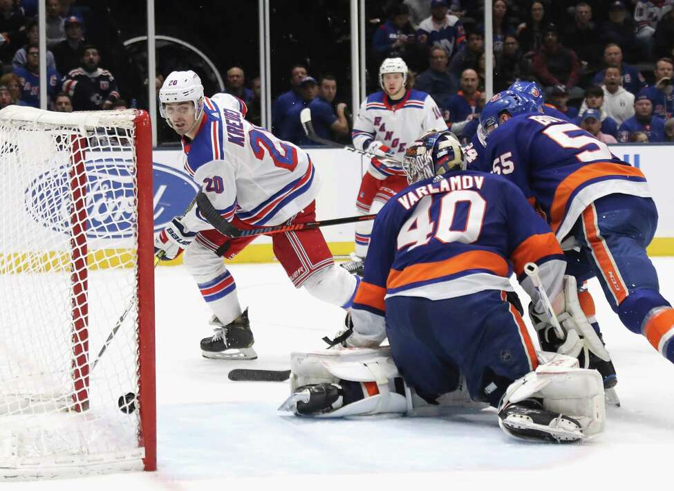 UNIONDALE, NEW YORK - JANUARY 16: Chris Kreider #20 of the New York Rangers scores the game winning goal on the power-play at 19:35 of the third period against the New York Islanders at NYCB Live's Nassau Coliseum on January 16, 2020 in Uniondale, New York. The Rangers defeated the Islanders 3-2. (Photo by Bruce Bennett/Getty Images)