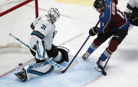 Colorado Avalanche right wing Valeri Nichushkin, right, scores a goal as the puck slips into the net past San Jose Sharks goaltender Martin Jones during the first period of an NHL hockey game Thursday, Jan. 16, 2020, in Denver. (AP Photo/David Zalubowski)