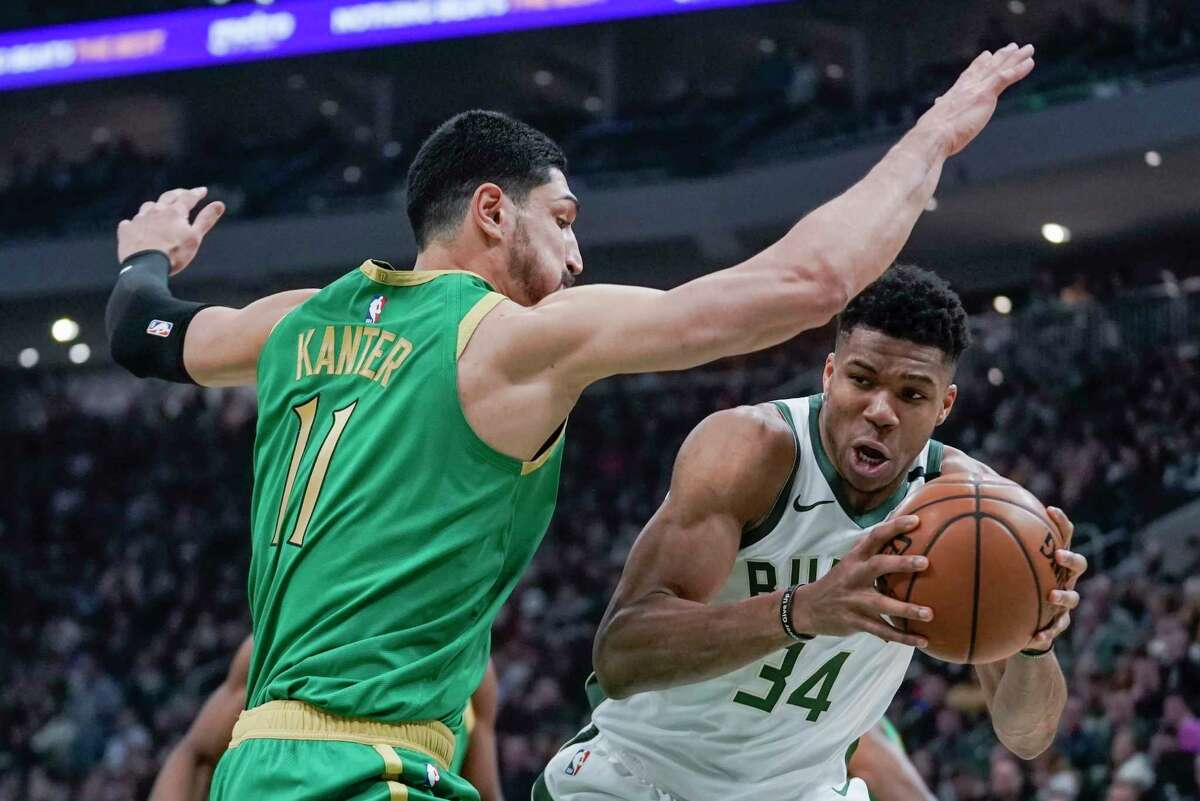 Milwaukee Bucks' Giannis Antetokounmpo tries to get past Boston Celtics' Enes Kanter during the first half of an NBA basketball game Thursday, Jan. 16, 2020, in Milwaukee. (AP Photo/Morry Gash)