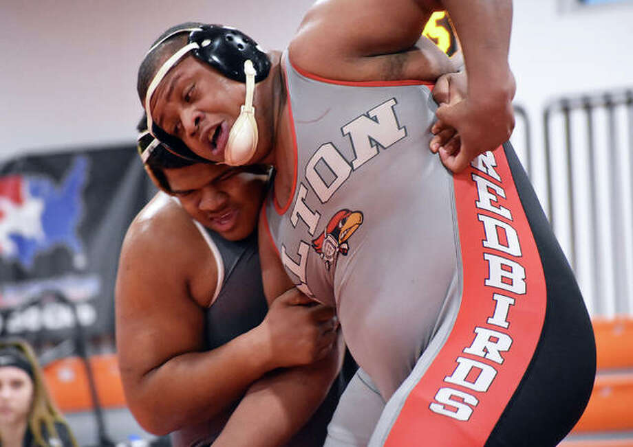 Alton's Kyle Hughes (right) tries to escape from Edwardsville's Lloyd Reynolds during the 285-pound match Thursday night at the Jon Davis Wrestling Center in Edwardsville. Photo: Matt Kamp / Hearst Midwest