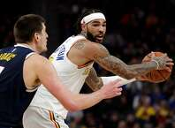 Willie Cauley-Stein (2) looks for a teammate to pass to In the first half as the Golden State Warriors played the Denver Nuggets at Chase Center in San Francisco, Calif., on Thursday, January 16, 2020.