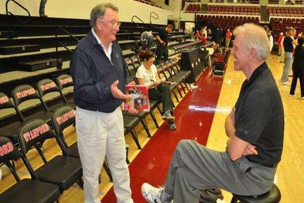 Bernie Schneider (left) talks with basketball great Bill Walton. USF will honor Schneider, who died in August, on Saturday.