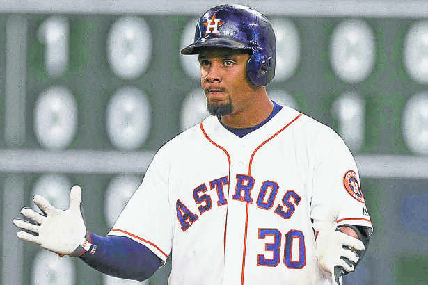 Carlos Gomez, of the Houston Astros, celebrates after hitting a double during the fourth inning of a MLB game at Minute Maid Park Tuesday, May 3, 2016, in Houston.