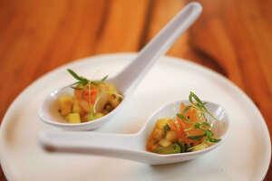 Vietnamese-brushed prawns with charred pineapple and shishito pepper vinaigrette at Mutiny Wine room Thursday, Jan. 16, 2020, in Houston.