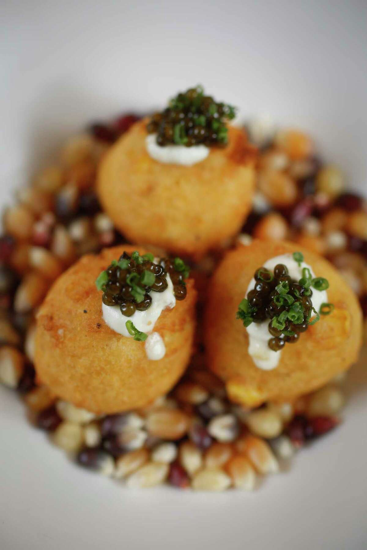 Hush puppies with whipped creme fraîche and caviar at Mutiny Wine Room.
