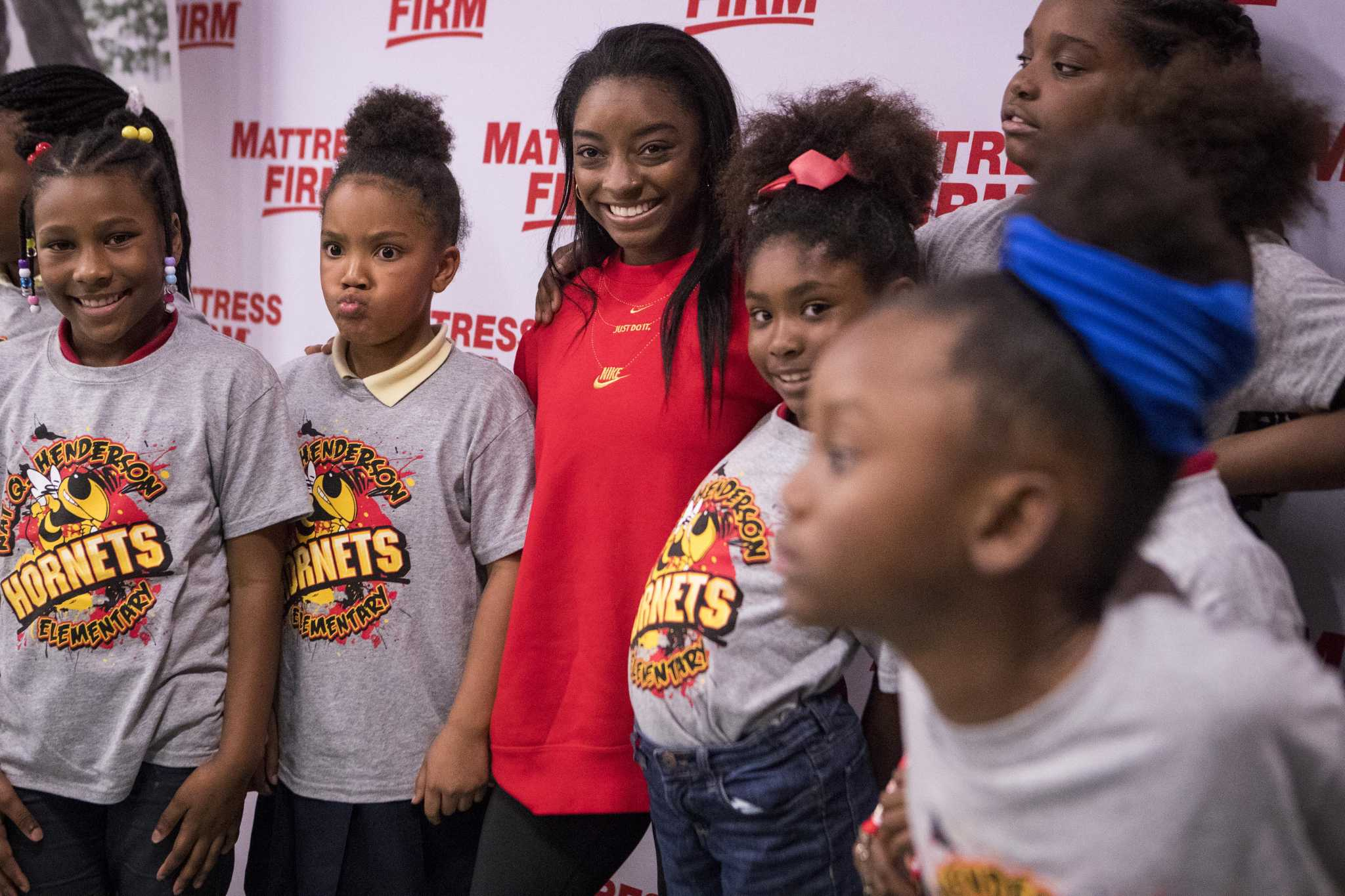 Olympic gold medalist Simone Biles surprises Houston elementary students