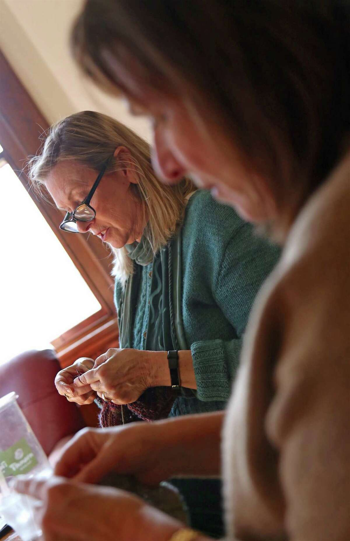 Barbara Bangser of Westport, left, and Lydia Kalt of Westport work on their craft at the weekly session of the Pequot Purls at Pequot Library on Thursday, Jan. 16, 2020, in Fairfield, Conn.