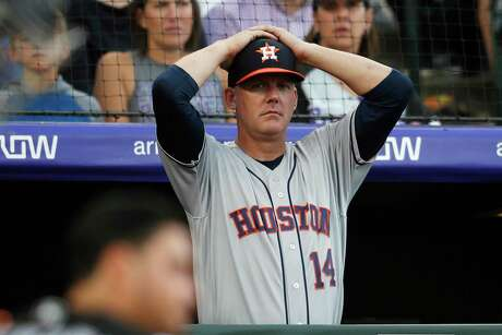 Astros manager AJ Hinch and general manager Jeff Luhnow were fired for the team's sign-stealing during its run to the 2017 World Series title. In this July 2, 2019, file photo, Houston Astros manager AJ Hinch reacts during a baseball game against the Colorado Rockies, in Denver.