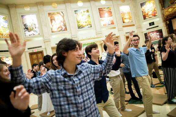 Emery/Weiner School students chant words and dance led by members of the Hare Krishna community during a visit to the ISKCON of Houston on Monday, Jan. 6, 2020, in Houston.